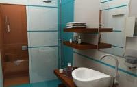 Fürdőszoba az Echo Residence All Suite Luxury Hotelben